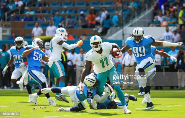 DeVante Parker of the Miami Dolphins tries to avoid the tackle of Jayon Brown of the Tennessee Titans in the first quarter on October 8 2017 at Hard...