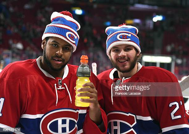 Devante SmithPelly and Alex Galchenyuk of the Montreal Canadiens warm ups wearing a Winter Classic hat before the NHL game against the Boston Bruins...