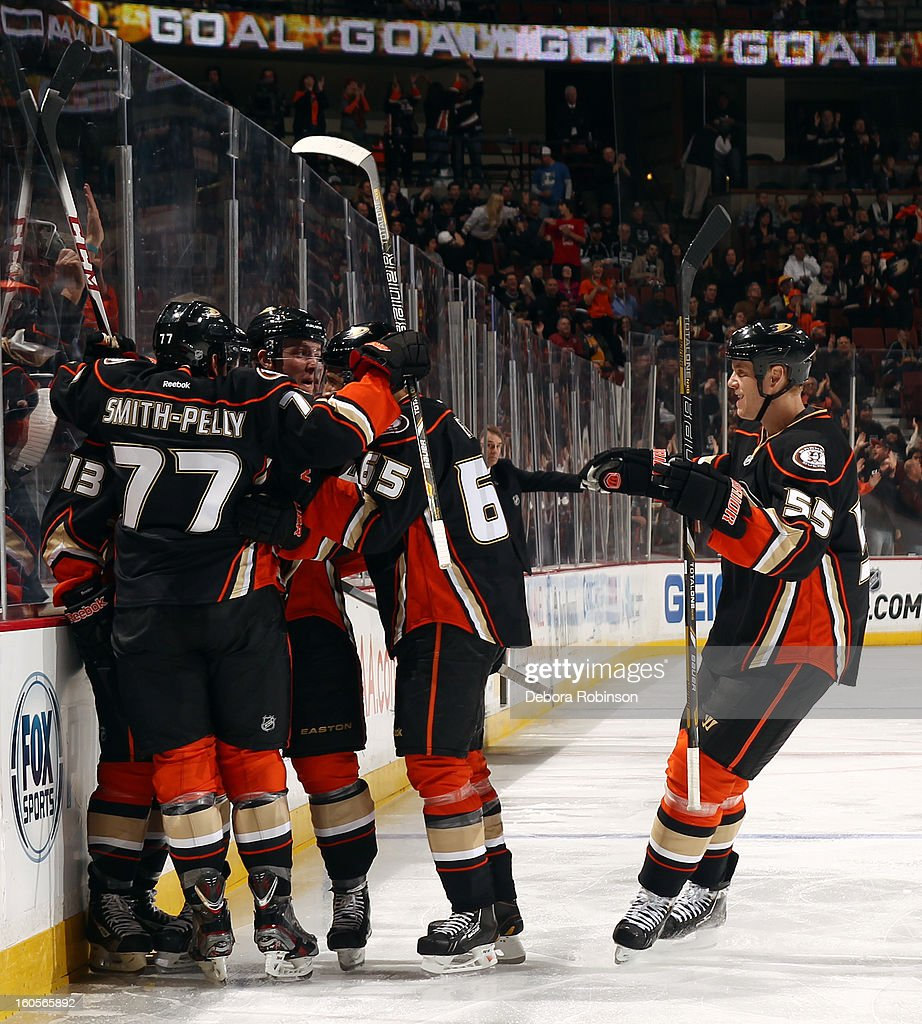 Devante Smith-Pelly #77, Emerson Etem #65, Bryan Allen #55 and Nick Bonino #13 of the Anaheim Ducks celebrate Bonino's goal in the first periopd of the game against the Los Angeles Kings on February 2, 2013 at Honda Center in Anaheim, California.