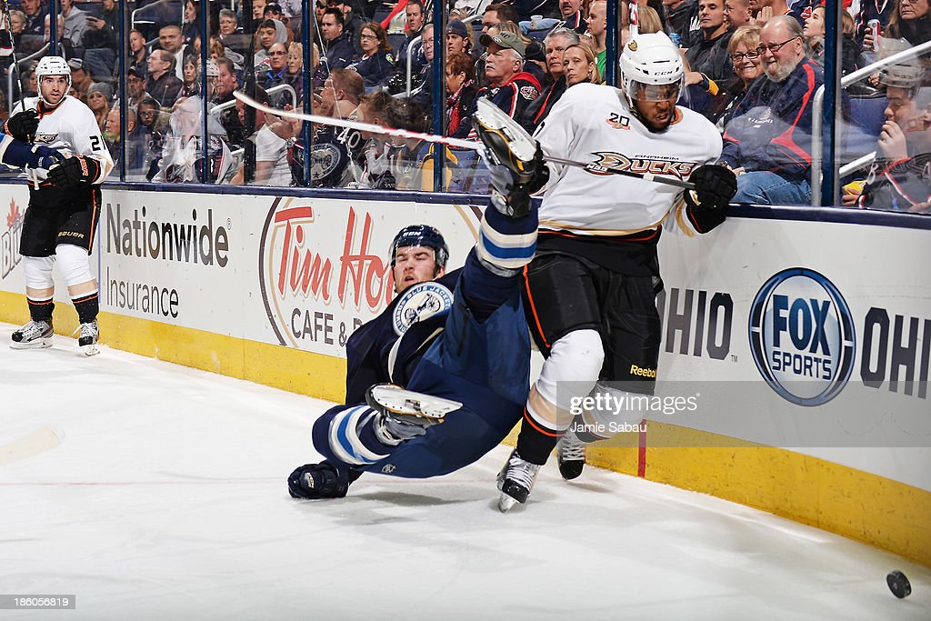 Devante Smith-Pelly #77 of the Anaheim Ducks attempts to gain possession of the puck as David Savard #58 of the Columbus Blue Jackets falls to the ice during the second period on October 27, 2013 at Nationwide Arena in Columbus, Ohio.