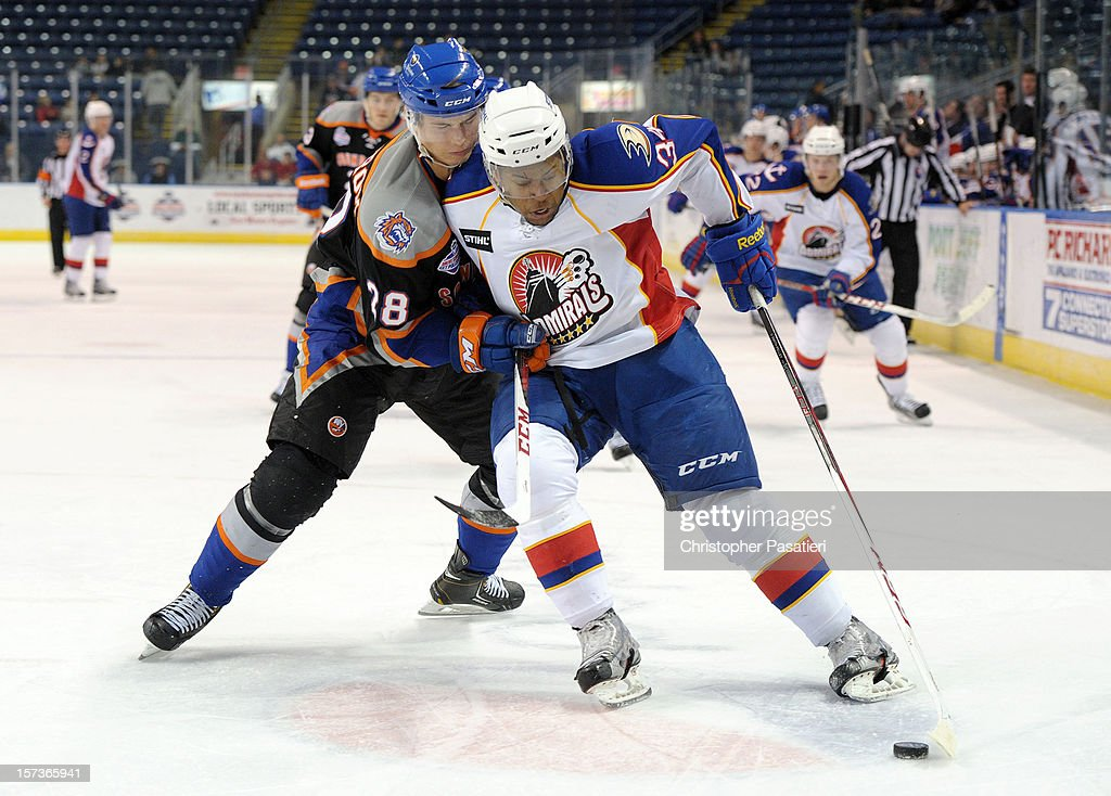 Devante SmithPelly of the Norfolk Admirals keeps Johan Sundstrom of the Bridgeport Sound Tigers from the puck during an American Hockey League game...