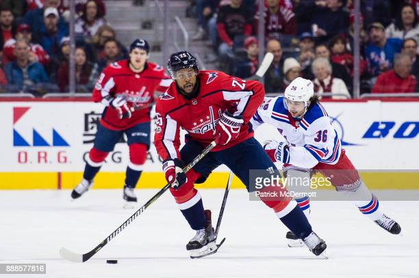 Devante SmithPelly of the Washington Capitals skates with the puck against Mats Zuccarello of the New York Rangers in the first period at Capital One...