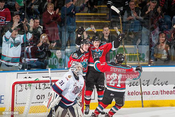 Devante Stephens Tomas Soustal and Kole Lind of the Kelowna Rockets celebrate an over time goal against Tyler Brown of the Regina Pats on November 26...