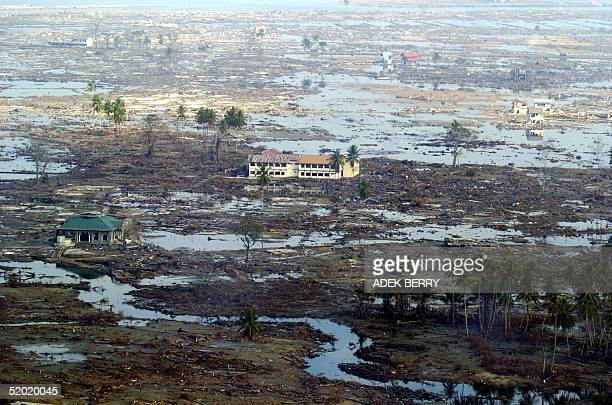 Devastated houses remain inundated after last month's tsunamis to have hit Aceh province 19 January 2005 The UN refugee does not plan to set up...