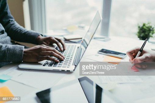 Developer and designer collaborating on a project : Stock Photo