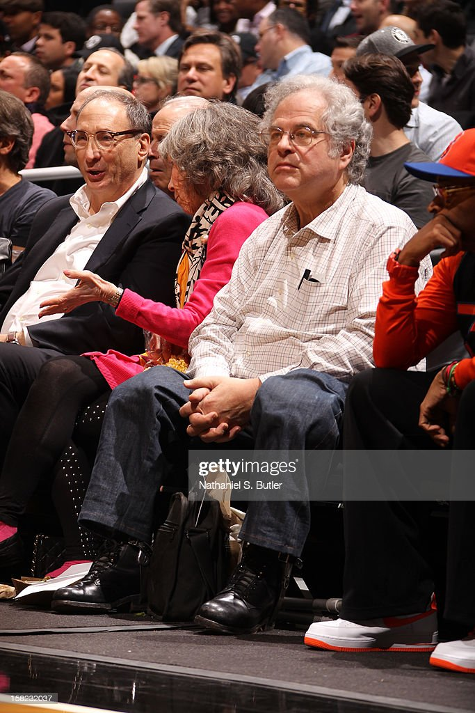 Developer and Part Owner Bruce Ratner violinist Itzhak Perlman and Director Spike Lee watch New York Knicks against the Brooklyn Nets on December 11, 2012 at the Barclays Center in the Brooklyn borough of New York City.