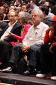 Developer and Part Owner Bruce Ratner violinist Itzhak Perlman and Director Spike Lee watch New York Knicks against the Brooklyn Nets on December 11...