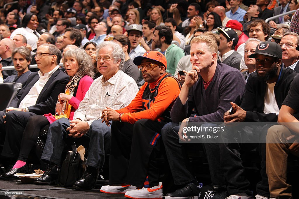 Developer and Part Owner Bruce Ratner violinist Itzhak Perlman Director Spike Lee and Actor Michael Rapaport watch New York Knicks against the Brooklyn Nets on December 11, 2012 at the Barclays Center in the Brooklyn borough of New York City.