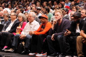 Developer and Part Owner Bruce Ratner violinist Itzhak Perlman Director Spike Lee and Actor Michael Rapaport watch New York Knicks against the...