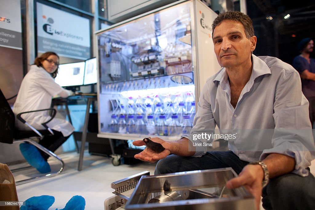 Developer Eran Lumbroso holds a mouse during a demonstration at The 2nd International Conference of Israel Homeland Security expo on November 12, 2012 in Tel Aviv, Israel. Israels Tamar Group has developed an explosives and drugs detection system, named Bio Explorer, using mice. An airport scanner style unit houses three concealed chambers, each containing eight mice. The animals are trained to run into an alarmed chamber upon substance detection.