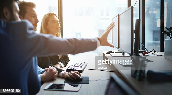 Developers at work. : Stock Photo