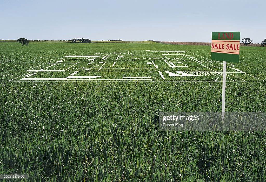 Development plans on lawn by 'land sale' sign (digital composite) : Stock Photo