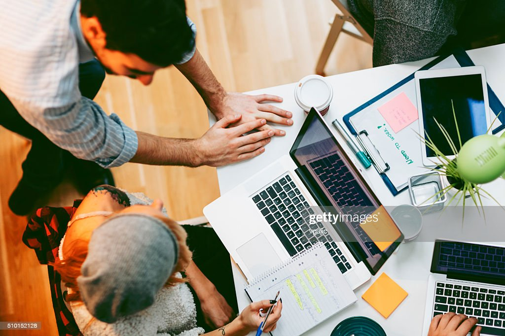 Development Team Cooperating In Their Office. : Stock Photo
