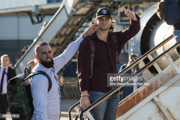 Deven Marrero and Andrew Benintendi of the Boston Red Sox boards the plane to Houston before the American League Division Series against the Houston...