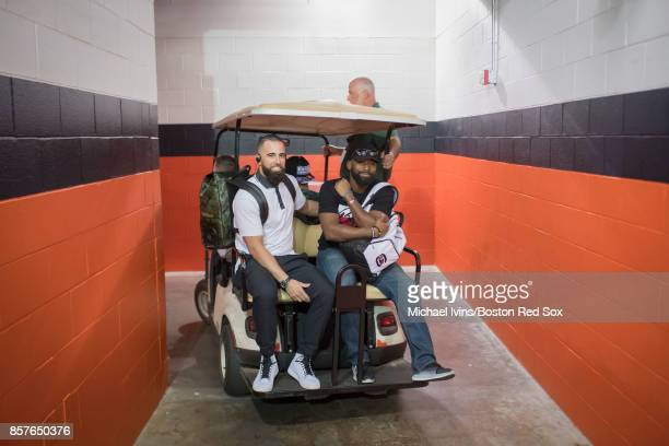 Deven Marrero and Jackie Bradley Jr #19 of the Boston Red Sox get a ride throughMinute Maid Park before a team practice on October 4 2017 in Houston...