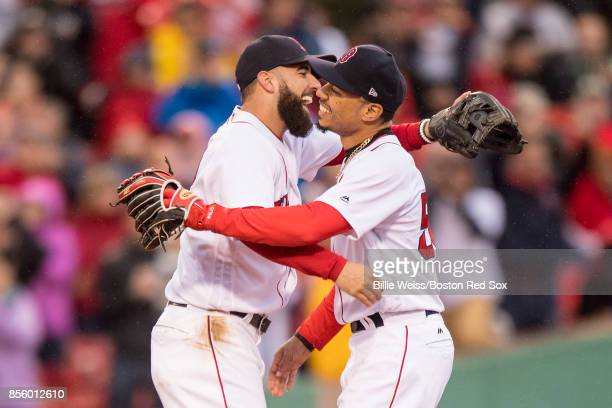 Deven Marrero and Mookie Betts of the Boston Red Sox react after the final out was recorded to clinch the American League East Division against the...