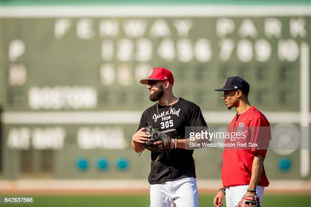Deven Marrero and Mookie Betts of the Boston Red Sox talk before a game against the Toronto Blue Jays on September 4 2017 at Fenway Park in Boston...