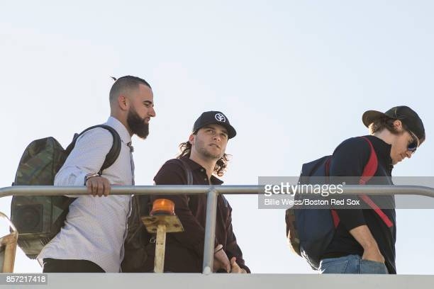 Deven Marrero Andrew Benintendi and Brock Holt of the Boston Red Sox boards the plane to Houston before the American League Division Series against...