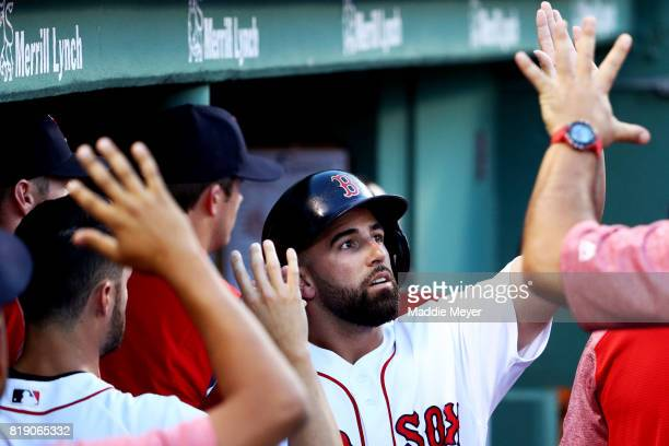 Deven Marrero of the Boston Red Sox celebrates in the dugout after scoring a run against the Toronto Blue Jays during the second inning at Fenway...