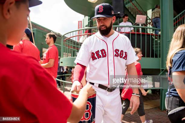 Deven Marrero of the Boston Red Sox collects money at the gates for Hurricane Irma relief before a game between the Boston Red Sox and the Tampa Bay...
