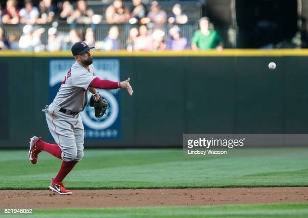 Deven Marrero of the Boston Red Sox makes the throw to get Jean Segura of the Seattle Mariners out at second base in the first inning at Safeco Field...