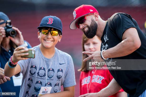Deven Marrero of the Boston Red Sox poses for a selfie photograph with a fan before a game against the Toronto Blue Jays on September 4 2017 at...