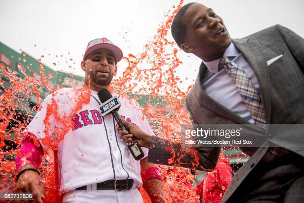 Deven Marrero of the Boston Red Sox reacts after getting doused with a Powerade shower while being interviewed by NESN anchor Jahmai Webster after a...
