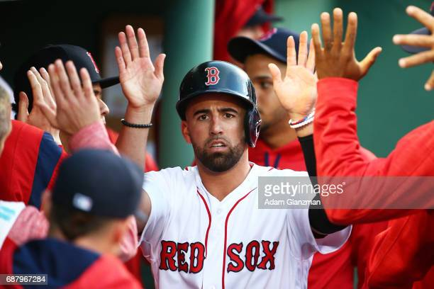 Deven Marrero of the Boston Red Sox returns to the dugout after scoring in the third inning of a game against the Texas Rangers at Fenway Park on May...