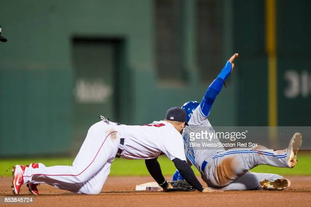 Deven Marrero of the Boston Red Sox tags out Ryan Goins of the Toronto Blue Jays as he attempts to steal second base during the fifth inning of a...