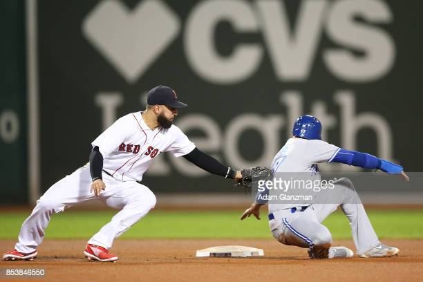 Deven Marrero of the Boston Red Sox tags out Ryan Goins of the Toronto Blue Jays in the sixth inning of a game at Fenway Park on September 25 2017 in...