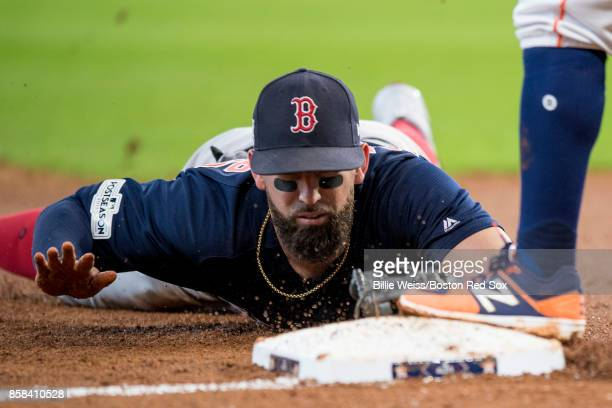 Deven Marrero of the Boston Red Sox tags third base after making a diving catch during the third inning of game two of the American League Division...