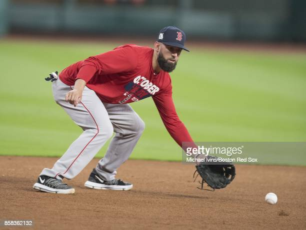 Deven Marrero of the Boston Red Sox takes ground balls before game two of the American League Division Series against the Houston Astros at Minute...