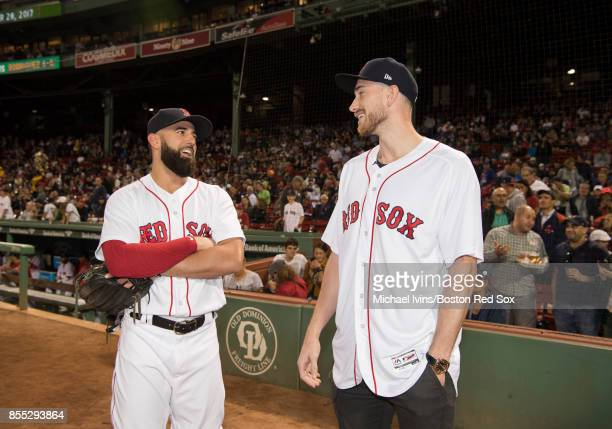 Deven Marrero of the Boston Red Sox talks to Gordon Hayward of the Boston Celtics before Hayward threw out a ceremonial first pitch at Fenway Park on...