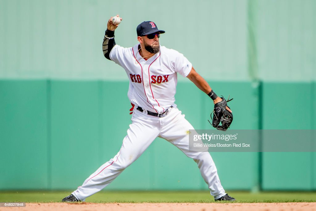 Deven Marrero #17 of the Boston Red Sox throws during the third inning of a Spring Training game against the Atlanta Braves on March 5, 2017 at Fenway South in Fort Myers, Florida .