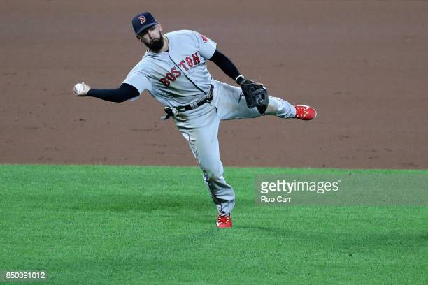 Deven Marrero of the Boston Red Sox throws to first base against the Baltimore Orioles in the eighth inning at Oriole Park at Camden Yards on...
