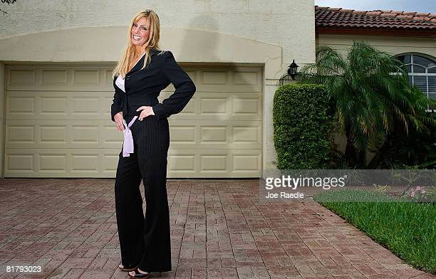 Deven Trabosh poses in front of the home that she is offering to sell on Craigslist along with the chance to marry her July 1 2008 in West Palm Beach...