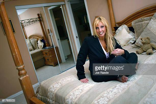 Deven Trabosh sits in the master bedroom of the home that she is offering to sell on Craigslist along with the chance to marry her July 1 2008 in...
