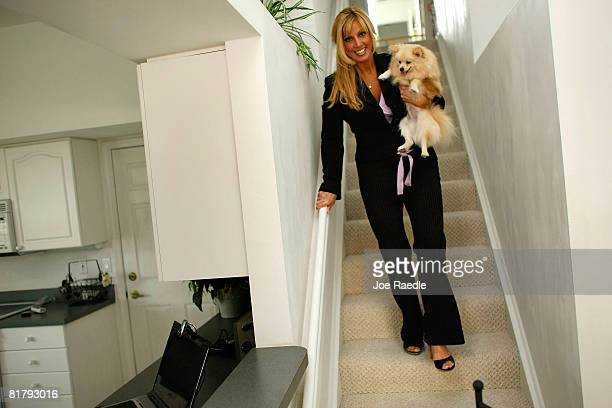 Deven Trabosh walks down the stairs with her dog in the home that she is offering to sell on Craigslist along with the chance to marry her July 1...