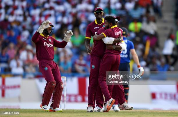 Devendra Bishoo of the West Indies celebrates with teammates after dismissing Jos Buttler of England during the 2nd One Day International match...