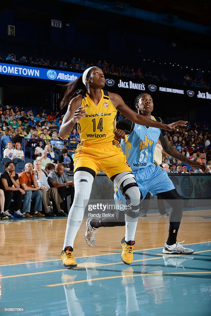 Devereaux Peters #14 of the Indiana Fever fights for position against Jessica Breland #51 of the Chicago Sky on June 29, 2016 at Allstate Arena in Rosemont, IL.