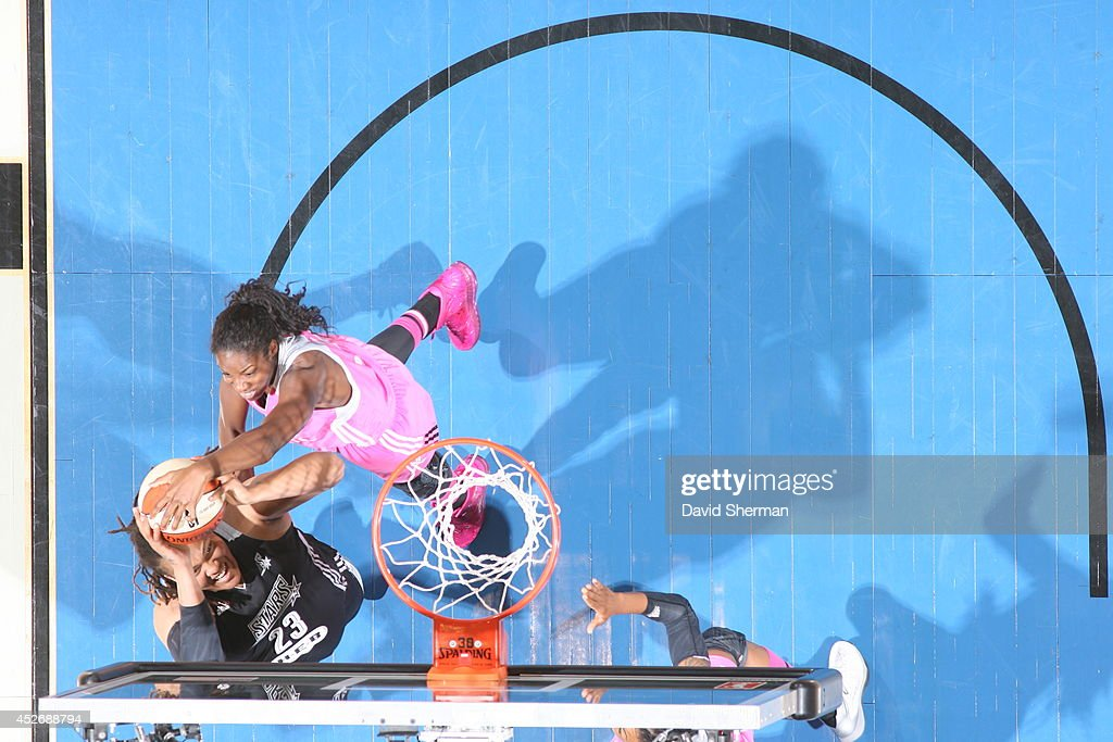 Devereaux Peters #14 of the Minnesota Lynx blocks <a gi-track='captionPersonalityLinkClicked' href=/galleries/search?phrase=Danielle+Adams&family=editorial&specificpeople=7537625 ng-click='$event.stopPropagation()'>Danielle Adams</a> #23 of the San Antonio Stars during the WNBA game on July 25, 2014 at Target Center in Minneapolis, Minnesota.