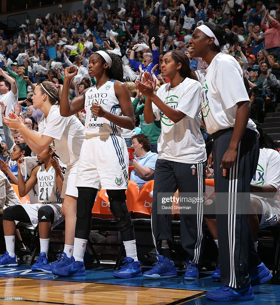 Devereaux Peters of the Minnesota Lynx cheers with the bench against the Phoenix Mercury during Game One of the WNBA Western Conference Finals on...