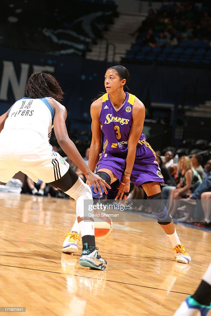 Devereaux Peters #14 of the Minnesota Lynx defends against <a gi-track='captionPersonalityLinkClicked' href=/galleries/search?phrase=Candace+Parker&family=editorial&specificpeople=752955 ng-click='$event.stopPropagation()'>Candace Parker</a> #3 of the the Los Angeles Sparks during the WNBA game on June 28, 2013 at Target Center in Minneapolis, Minnesota.