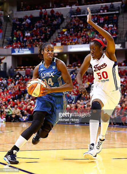 Devereaux Peters of the Minnesota Lynx dribbles to the hoop against Jessica Davenport of the Indiana Fever during Game Three of the 2012 WNBA Finals...