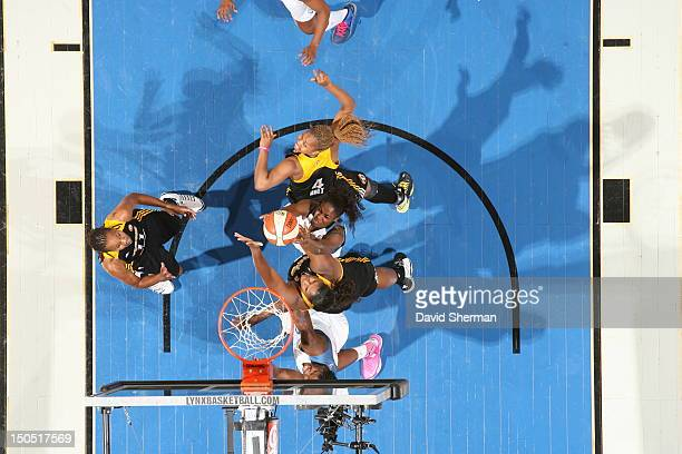 Devereaux Peters of the Minnesota Lynx fights for the rebound against Courtney Paris Amber Holt and Chante Black of the Tulsa Shock during the WNBA...