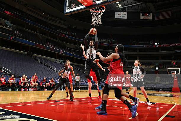 Devereaux Peters of the Minnesota Lynx grabs a rebound against the Washington Mystics during an Analytic Scrimmage at the Verizon Center on May 26...