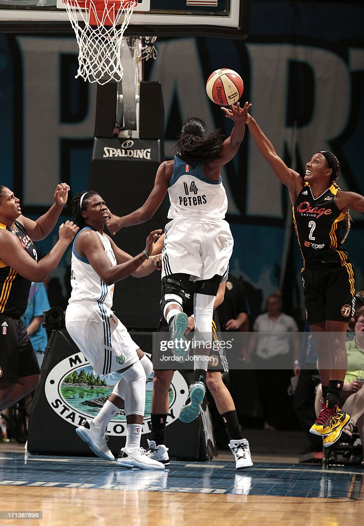 Devereaux Peters #14 of the Minnesota Lynx shoots against <a gi-track='captionPersonalityLinkClicked' href=/galleries/search?phrase=Candice+Wiggins&family=editorial&specificpeople=2999713 ng-click='$event.stopPropagation()'>Candice Wiggins</a> #2 of the the Tulsa Shock during the WNBA game on June 23, 2013 at Target Center in Minneapolis, Minnesota.