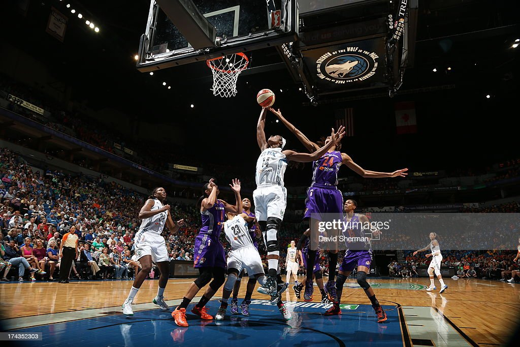 Devereaux Peters #14 of the Minnesota Lynx shoots against DeWanna Bonner #24 of the the Phoenix Mercury during the WNBA game on July 24, 2013 at Target Center in Minneapolis, Minnesota.
