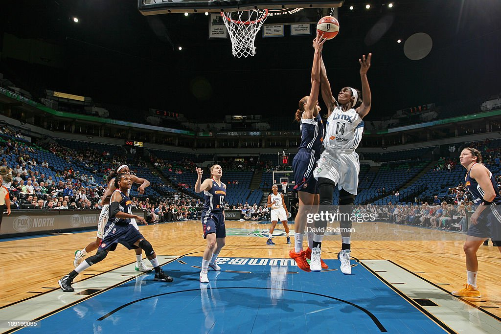 Devereaux Peters #14 of the Minnesota Lynx shoots against Mistie Bass #8 of the Connecticut Sun during the WNBA pre-season game on May 21, 2013 at Target Center in Minneapolis, Minnesota.