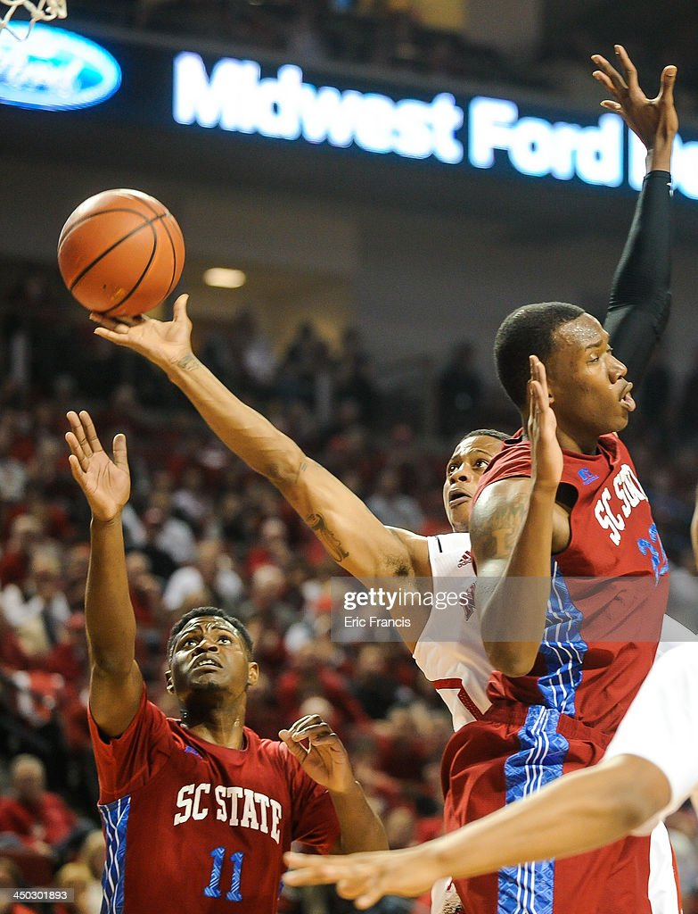 Deverell Biggs #1 of the Nebraska Cornhuskers drives between Shaquiell Mitchell #11 of the South Carolina State Bulldogs and Matthew Hezekiah #22 of the South Carolina State Bulldogs during their game at Pinnacle Bank Arena on November 17, 2013 in Lincoln, Nebraska.